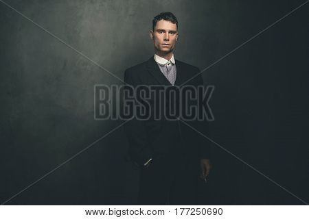 Retro 1920S English Gangster Standing With Cigarette.