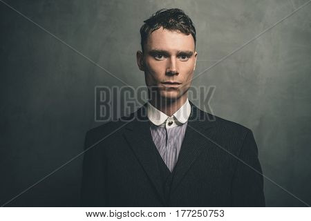 Portrait Of Retro 1920S English Gangster In Suit.