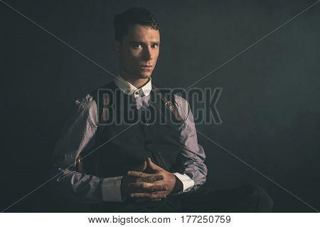Threatening Retro 1920S English Gangster Sitting With Gun.
