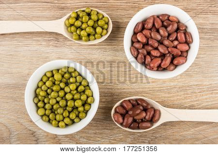 Wooden Spoons, Bowls With Red Baked Beans And Green Peas