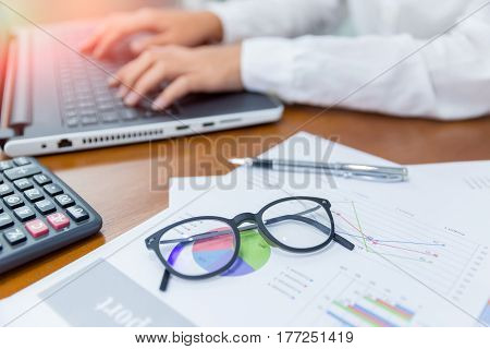 Business Concept;Business woman working with business document and laptop on the table