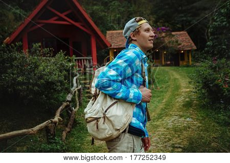 Man with a backpack hiking in forest.