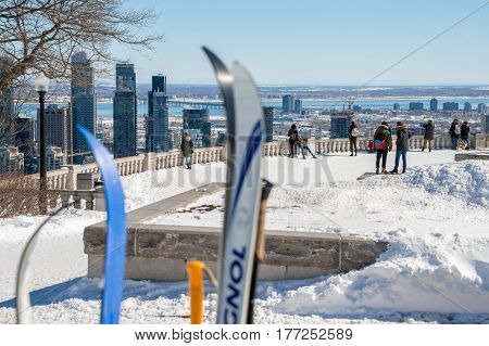 Montreal Canada - 17 March 2017: Skis in snow with Montreal skyline in the distance