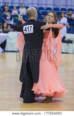Minsk Belarus-February 18 2017: Senior Dance Couple of Poddubnyak Oleg and Puddubnyak Irina Performs European Standard Program on WDSF Minsk Open Dance Festival-2017 Championship in February 19 2017 in Minsk Belarus
