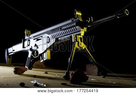 Yellow side lighting on an assault rifle with a dark background