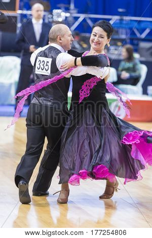 Minsk Belarus-February 18 2017: Senior Dance Couple of Nesterovich Igor and Verbol Nataliya Performs European Standard Program on WDSF Minsk Open Dance Festival-2017 Championship in February 19 2017 in Minsk Belarus.