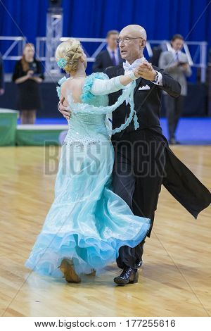Minsk Belarus-February 18 2017: Senior Dance Couple of Kaplin Anatoliy and Zhudrik Ekaterina Performs European Standard Program on WDSF Minsk Open Dance Festival-2017 Championship in February 19 2017 in Minsk Belarus.