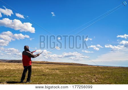 Man Relaxes In Nature To Raise A Kite