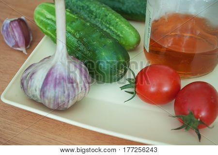 Different fresh vegetables on the plate summer harvest