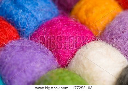 color wool background - balls of syntetic wool yarn - geometric rainbow pattern