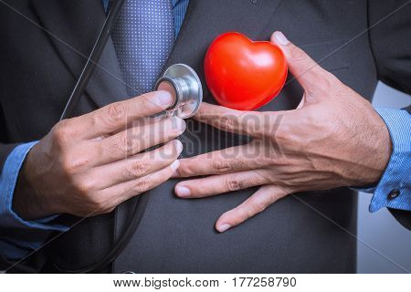 Male doctor showing stethoscope for checkup heart heart care concept.