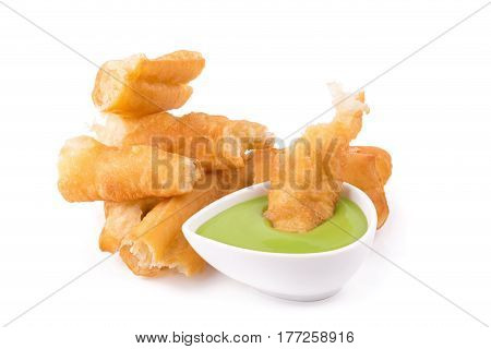 deep fried dough stick and steamed custard on white background.