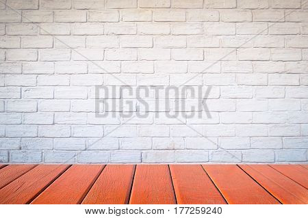 Empty wood table top and brick background with copy space used for display or montage your products.