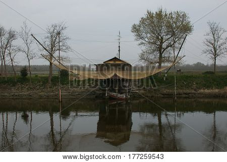 Stilt house and fishing nets along the Po Delta, Italy