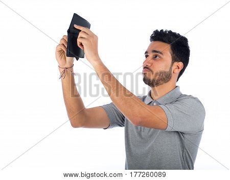 Young man looking to empty wallet isolated