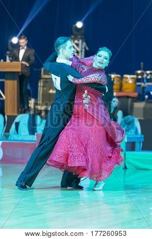 Minsk Belarus-February 19 2017: Pro-Am Dance Couple Performs Pro-Am Super Cup International European Standard Program on WDSF Minsk Open Dance Festival-2017 on February 19 2017 in Minsk Belarus.