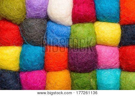 color wool background - balls of wool yarn - geometric rainbow pattern