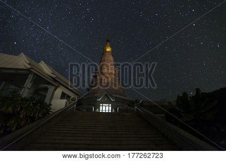 View of Phra Maha Dhatu Nabha Metaneedol and Phra Maha Dhatu Nabhapol Bhumisiri with milky way in galaxy, Chiangmai, Thailand.