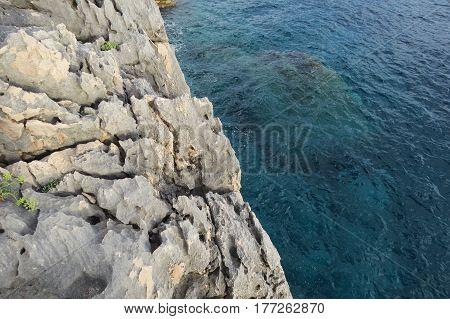 Deep blue Adriatic sea near the big stone rock