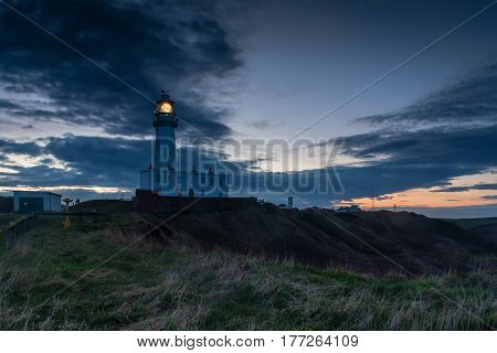 Light on Flamborough Head Lighthouse - Flamborough Head is an eight mile long promontory on the Yorkshire coastline. It is a chalk headland with sheer white cliffs