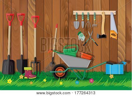 Gardening tools set. Equipment for garden. Saw bucket ax wheelbarrow hose rake can shovel secateurs gloves boots. Wooden fence, flower, grass. Vector illustration in flat style
