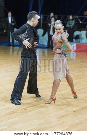 Minsk Belarus-February 19 2017: Professional Dance Couple of Kosyakov Egor and Navoychik Anna Performs Adults Latin-American Program on WDSF Minsk Open Dance Festival-2017 on February 19 2017 in Minsk Belarus.