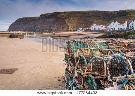Lobster Pots on Staithes Pier - Staithes is a pretty seaside village and fishing port on the North Yorkshire coastline and is today an attractive tourist destination