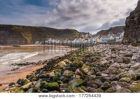 Rocks in Staithes Harbour - Staithes is a pretty seaside village and fishing port on the North Yorkshire coastline and is today an attractive tourist destination