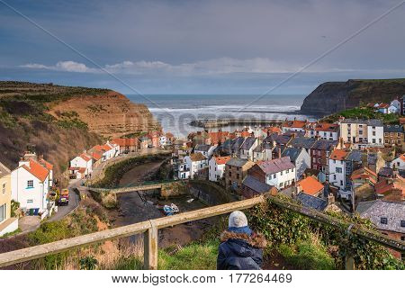 Elevated View of Staithes Village - Staithes is a pretty seaside village and fishing port on the North Yorkshire coastline and is today an attractive tourist destination
