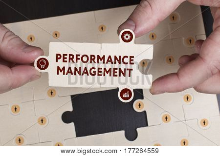 Business, Technology, Internet And Network Concept. Young Businessman Shows The Word: Performance Ma
