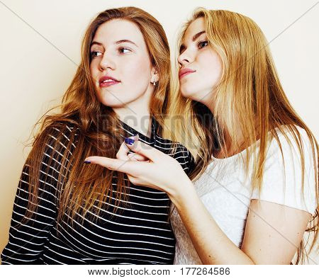 best friends teenage girls together having fun, posing emotional on white background, besties happy smiling, lifestyle people concept close up