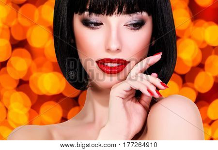 Pretty woman against an abstract background with blurred lights