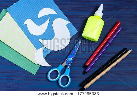 Making a greeting card for Mother's Day. Children's art project. DIY concept. Step-by-step photo instruction. Step 1. Preparation of materials and tools (paper templates scissors glue markers)