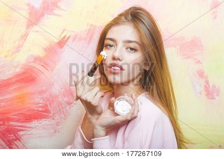Pretty Girl Putting Facial Cream Or Mask On Face Skin