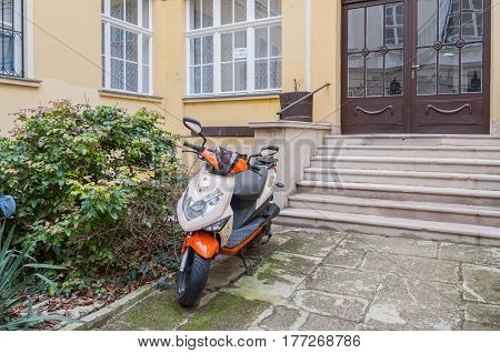 BUDAPEST HUNGARY - FEBRUARY 20 2016: Scooter on the background of the Hungarian house in Budapest.
