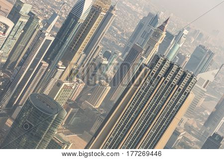 Aerial view of Dubai downtown skyscrapers. Sheikh Zayed Road skyscrapers. Dubai Metro station Financial center.