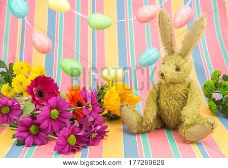 Happy Easter Scene. Rabbit And Bright Colored Flowers.