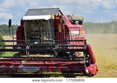 NARO-FOMINSK RUSSIA - JUL 31 2016: Harvesting of wheat. Combine Harvester in agricultural fields. Russia ranks first in the export of wheat in the world is continuously increasing grain production