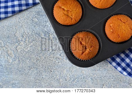 Homemade hot muffins in the form of a concrete background