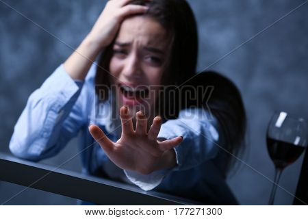 Depressed young woman with outstretched arm, closeup