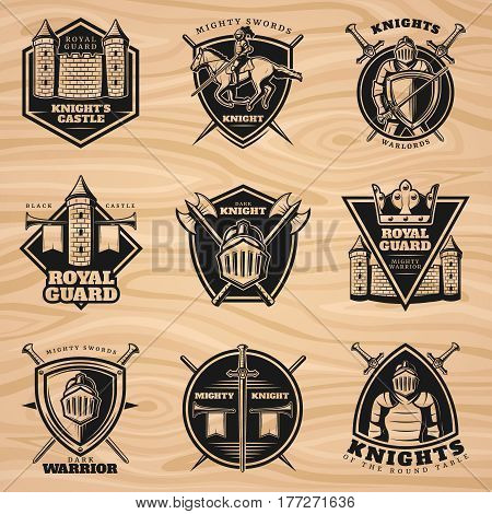 Black vintage knights emblems set with medieval weapon shield  castle and tower on wooden background isolated vector illustration
