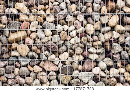 Stones with an iron grid part of a protective decorative structure