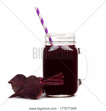 Mason Jar Glass Of Beet Juice With Straw And Surrounding Beets Isolated On A White Background