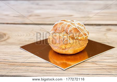 eclairs on a wooden background. A close up
