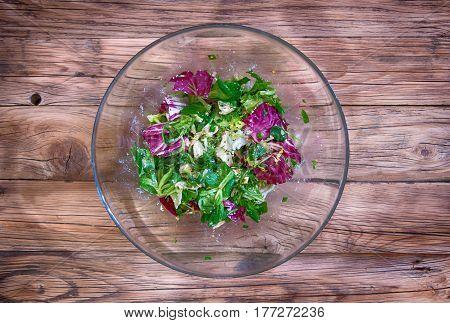 a fresh salad vegetables on wooden background