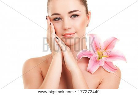 Cute woman with flower. Care for beautiful woman skin. Cosmetology, spa therapy and makeup at beauty salon. Closeup portrait of woman face with beautiful lily flower