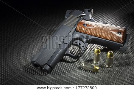 Semi automatic pistol on a rubber mat with ammunition