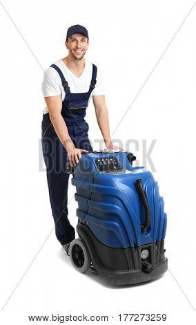 Dry cleaner's employee with special equipment on white background