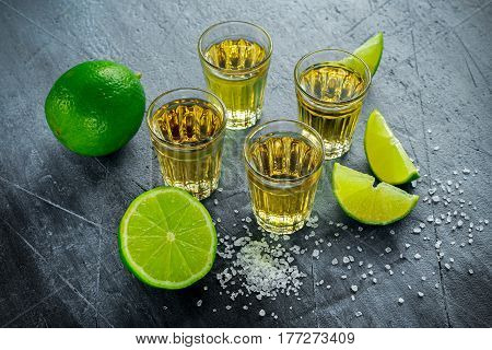 Gold Tequila shots with lime and sea salt.