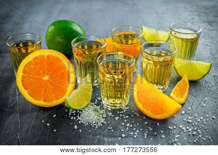 Gold Tequila shots with lime, orange and sea salt.